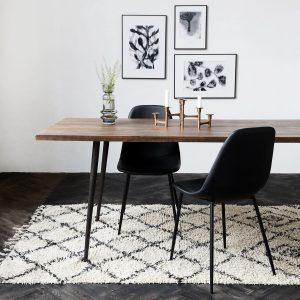 Een vloerkleed onder je eettafel zorgt voor een mooi geheel